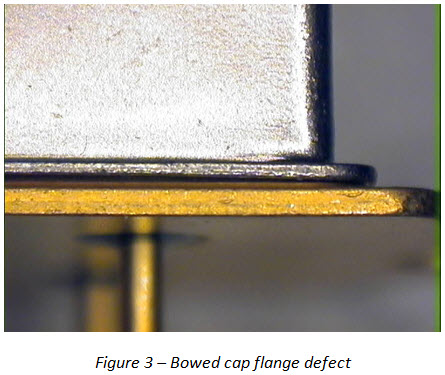 Bowed cap flange defect